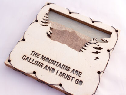 Mountains are Calling text with Mountains Home Decor with four layers of wood